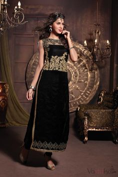 Black long-sleeved straight cut suit with embroidered unique bodice pattern along with work details at bottom and contrast lace at side slits. Comes with matching velvet bottom. Ideal to stand out in your next party.
