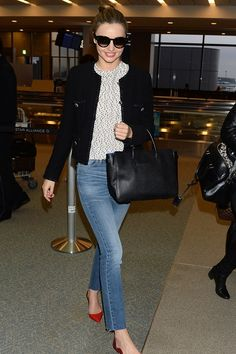 Miranda Kerr was given a superstar reception by waiting fans as she jetted into Narita airport in Japan this week. And she didn't disappoint on the fashion front either. Skinny jeans, red slingbacks and a cropped black blazer were her go-to airport essentials, the perfect blend of relaxed sophistication.