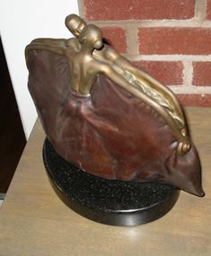 Purse Bronze Sculpture 2005 by Vladimir Kush