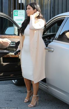 Looking bright: Kim Kardashian looked radiant as she stepping out in a figure-hugging white dress on Monday