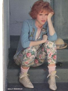 Contrary to popular belief, the 1980's wasn't all about flashy Madonna-eque garb. Teen actress Molly Ringwald hanging out in everyday wear, in 1984.