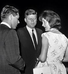 Jackie Kennedy with her husband JFK and her brother-in-law Robert Kennedy