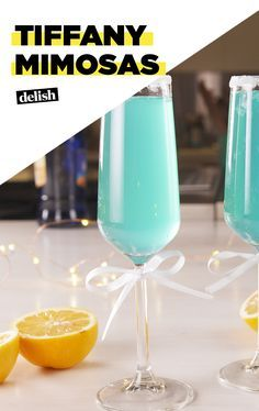 These mimosas give Breakfast at Tiffany\'s a WHOLE new meaning. Get the recipe at Delish.com. #recipe #easyrecipe #easy #mimosa #brunch #cocktail #wine #sparklingwine #party #partyplanning #partyideas #tiffanyandco