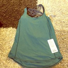 Lululemon Wild Tank Brand NWT! Lululemon Wild Tank In green & gray combo. Bra cups included. Loose fitting. lululemon athletica Tops Tank Tops