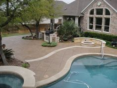Another beautiful pool deck design feature from Sundek of Austin.  This Stamped overlay surface it such a wonderful way to finish out a large concrete surface such as this.