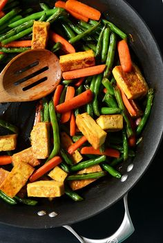 Veggie and tofu stir-fry made tasty with a special, easy technique for giving the tofu more texture and flavor. Serve over rice or on its own - a healthy and delicious weeknight meal.