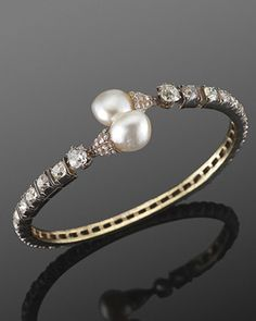 19th Century Pearl and Old Mine Diamond Flexible Crossover Bangle Bracelet. Fred Leighton