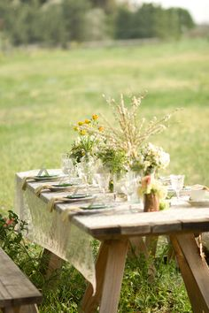 Picnic, white lace table cloth, lots of blooms, farm (or picnic) table and a lovely field