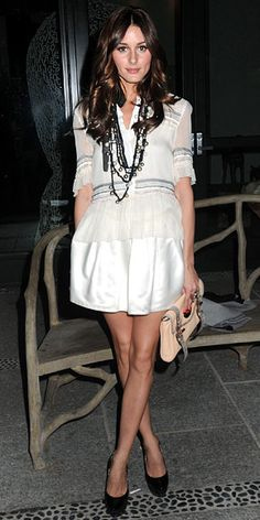 Olivia Palermo wore a full satin skirt, sheer blouse, patent pumps and a Mulberry clutch.