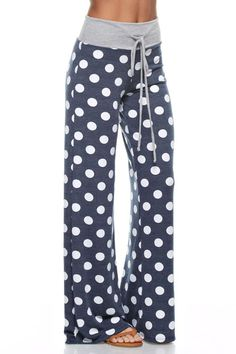 Navy Polka Dot Lounge Pants - Fabric Content: 68% POLYESTER 29% RAYON 3% SPANDEX - Made In USA Items will fit differently depending on body type. Pattern will vary due to the cut of fabric and may not