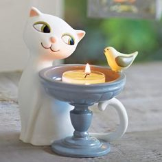 ** PartyLite TOP TEN (Winter/Spring) ** ~ Garden Diva Tealight Holder Item Playful feline and feathered friend eye each other over a birdbath of light. For use with a tealight, sold separately. Clay Art Projects, Candels, Air Dry Clay, Tea Light Holder, Hand Painted, Painted Porcelain, Birthday Candles, Tea Lights, Cool Things To Buy
