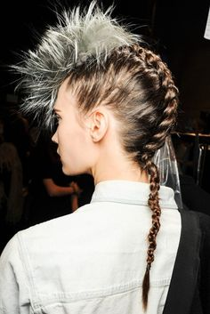 Feathered faux hawks sat atop reptilian braids at Fendi A/W 2013