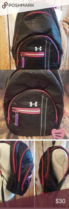Under Armour Black & Pink Backback  Water resistant finish black with pink trim & inside backpack by Under Armour!  Lightweight but highly functional!!! Foam padded shoulder straps & back panel. Shoulder straps are ergonomically contoured to better fit a woman's back & very comfortable!!! LOTS of compartments!  Separate area for drinks, laptop, keys, pens, phone, you name it!  Pink heart key chain is removable. Only used 1 semester, like new condition!!! Under Armour Bags Backpacks