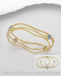 $42.00 Product Features: Bangle  Product Type: Bracelet Metal: Brass Decorated With: Lab-Created Blue Chalcedony, Lab-Created Light Sky Blue Chalcedony Setting Type: Bezel Plating: 18k Yellow Gold  Width: 7 mm. Diameter: 68 mm.