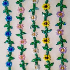 These sweet daisy chain chokers are so pretty and fresh! Ive been making them forever but just recently added the fire polished leaves. I think it takes them to a new level of cute!  I use super strong Fireline gel-spun polyethylene thread for durability, so they are secure no matter how active you are!  They are 16 inches long which is standard choker length. Ill also be happy to make a custom length for you! They close with a silver plated spring clasp.
