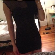 Free People Dress Super sexy, form fitting, black mini dress from Free People! Top part is sheer black with tiny black dots and the rest is solid black with gold detailing throughout. Never worn! purchased at South Moon Under. Free People Dresses