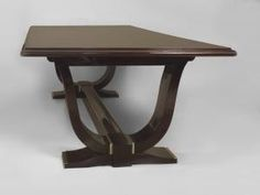 """French Art Deco rosewood dining table supported by 2 """"U"""" form pedestal bases and stretcher having nickel trim (2- 20.5"""" leaves; overall length with leaves 157.25)"""