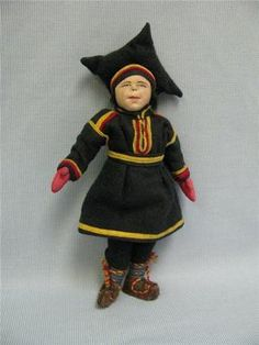 """A rare & wonderful needle-sculpted hand-painted face graces this dear 8.5"""" little guy of the SAAMI people of Lapland and Finland, he's hand-made, all cloth and authentically dressed in soft wool flannel trimmed in yellow & red and wearing the classic male """"Hat of the Four Winds""""; Kimport tag under tunic with woven""""THIS DOLL WAS MADE IN"""" and typed """"FINLAND"""".    He also has a hand-written provenance '""""Ollie from Finland-"""" // From Bert June 13th 1937"""