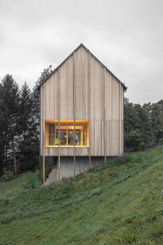 Bernardo Bader perches larch-clad home over concrete plinth in Austrian mountains