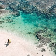 Turquoise waters lap against the shallow reefs of Suluban beach - once a secluded secret, now one of the most popular surf spots in southern Bali.