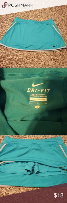 Nike Dri-Fit skort Cute Nike skirt with the built it shorts. Excellent condition. Nike Skirts