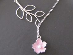 Branch and pink resin orchid by Thedandelionjewelry