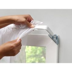"""Make your windows beautiful without putting ugly holes in your wood moldings or walls! Hang curtains without a single nail or screw! The set of eight easy-mount curtain hangers is so simple to use. Each steel bracket slides into place over the top corners of any window molding up to ¾"""" thick and 2"""" wide. Double hooks on each bracket allow for two rods on each window."""