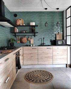 The texture of the wood cabinets against the lines of the green tile backsplash. This kitchen does balance right! ( The texture of the wood cabinets against the lines of the green tile backsplash. This kitchen does balance right! Home Decor Kitchen, Kitchen Interior, Home Kitchens, Bohemian Kitchen Decor, Bohemian Interior, Interior Walls, Modern Bohemian Decor, Bohemian Decorating, Bohemian Homes
