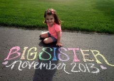 first comes love: chalk pregnancy announcement