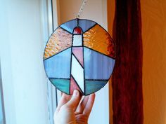 Stained glass suncatcher Rainy Night on the Lighthouse by caracoja