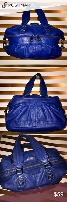 "BCBGMaxAzria Leather Bag 💋 This Bag is gorgeous! Beautiful blue leather, nice and roomy. It's in great condition! 2 zip up pockets on the front of the bag. 1 zipper pocket inside and 2 pockets for cellphone. Footed bottom, 9"" deep, 14"" length 6"" width and strap drop 8"". BCBGMaxAzria Bags Shoulder Bags"