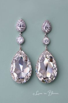 Elegant and sophisticated Wedding Swarovski crystal chandelier earrings are a glamorous accessory for a Bride. By Luxe in Bloom