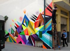Check out the wall art in this picture. There is a lot of color here. If you were to grab about eight different spray paint cans you could do this on the cheap for a wall in your youth room.