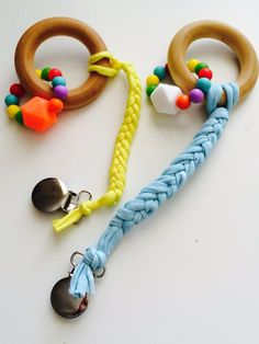 This is our Newest Product Our Teether and Shortie Pacifier Clip. Teether is actually 2 Teethers! The Wooden Ring and the Silico. Teething Beads, Teething Jewelry, Baby Gym, Baby Play, Diy Bebe, Handmade Baby Gifts, Dummy Clips, Baby Teethers, Wooden Rings