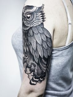Upper arm owl tattoo. Really gorgeous alternative for a sleeve. Detail is brilliant, it's a little geometric