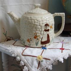 Teapot with doll*