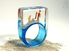 Summer breeze – summerlike beach figure ring with mini figures and sand on a light blue ring made of resin for the holiday feeling by GeschmeideUnterTeck on Etsy https://www.etsy.com/listing/152610050/summer-breeze-summerlike-beach-figureMore Pins Like This One At FOSTERGINGER @ PINTEREST No Pin Limitsでこのようなピンがいっぱいになるピンの限界