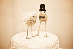 Bird cake toppers...perfect for a rustic chic wedding! (Photo by Blaine  Photography)