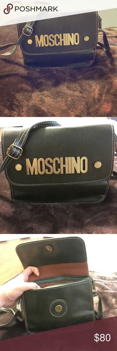 """Crossbody bag Dark green crossbody bag, brass hardware, super trendy! """"Moschino"""" on front. Brand new but not genuine leather therefore price will reflect. Shoulder strap has an adjustable buckle so the length can be completely customizable for your body. Size of bag: 7in X 6in X 2.5in Bags Crossbody Bags"""