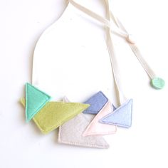 Kid Friendly - Triangle Party Necklace. $40.00, via Etsy.