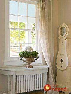 White on White: White walls create a neutral backdrop that lets your furnishings and accents shine. Linen curtains casually drape the front window and drag on the floor. A demilune table with a distressed white finish sits over the radiator. Radiator Shelf, Radiator Cover, Radiator Ideas, Radiator Screen, Radiator Heater, French Decor, French Country Decorating, Country French, Swedish Decor