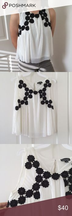 Topshop ruffled sleeveless blouse Elegant topshop chiffon/ruffled sleeveless blouse with black crocheted flowers stitched on. New without tags. Super light and chic. Topshop Tops Blouses