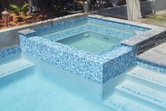 This pool above features GC410 Nautilus 25mm mosaic tiles as the waterline tile and step marker tile. GC410 Nautilus 25mm has also been used on the spa overflow. - Pool Tile Company Pty Ltd The, Home Decor Retailers, Newstead, QLD, 4006 - TrueLocal