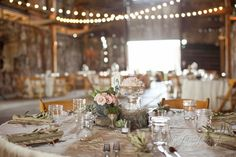 This eclectic barn wedding, incorporates mason jars, potted plants, and blush tones to  give an Anthropologie-esque feel.
