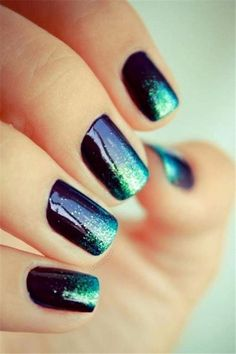 Pretty dark blue and turquoise glitter nail art.