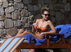 During that getaway, Jessica Alba sported a hot-pink two-piece and showed off the beach-ready physique that landed her a spot among our sexiest bikini moments of the year.