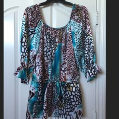 "Sexy Silky cheetah print top Blue, brown, torquiose silky shirt or tunic, cheetah print in places, drawstring waist allows for top to be worn at natural waist or at hips, super cute! Fit medium and a ""smaller"" large.  Brand M by M.Kalan Tops Blouses"