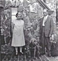 Laura and Almanzo with their dog Nero, the Rock House their daughter Rose built for them, Rocky Ridge Farm.
