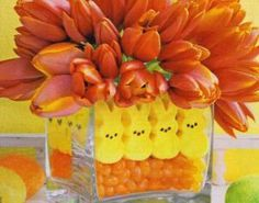 LOL, So fun!!  What's in the middle of our table this Easter?  Fresh flowers of choice placed in a separate container with water, set inside a larger vase, fill with your choice of interesting, fun and yummy candy.  www.ashleyandken.com