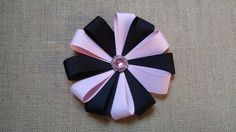 Pink and black rhinestone flower. This large flower hairbow will make a great hair accessory for your little girl. During checkout you can choose between a french barrette or an alligator hair clip. Flower hairbow measures approximately 5 across. All ends of ribbon have been heat sealed to prevent fraying. This bow is made with small parts, never leave children unattended.  You can visit my shop at www.etsy.com/shop/GloriaMillerCreation to see more of my hairbows and headbands